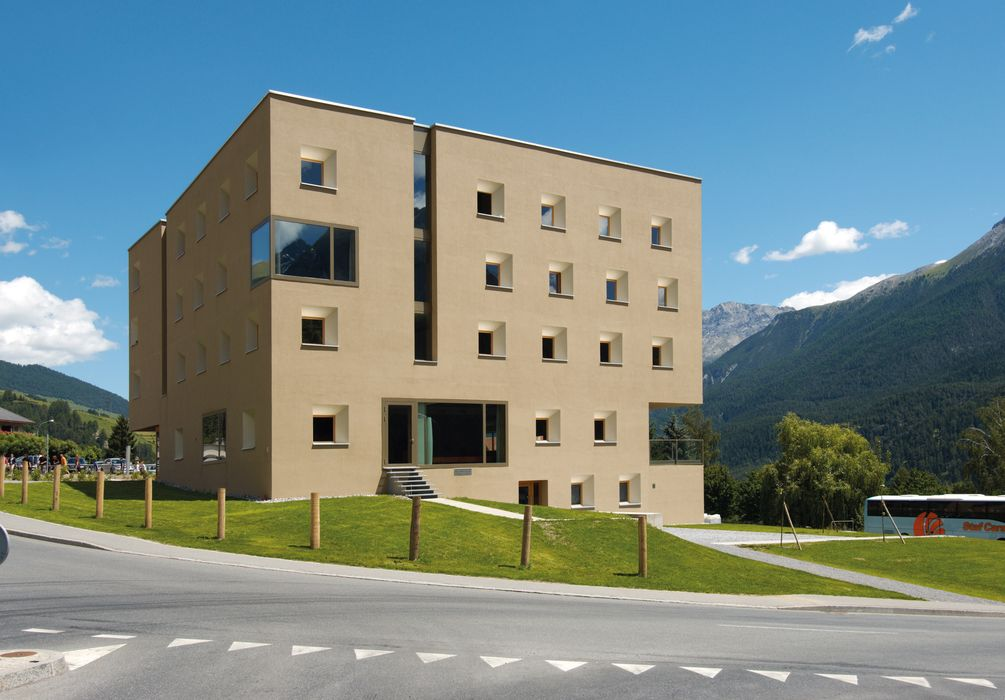 Outside view and house with the street Scuol Youth Hostel